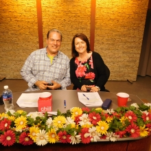 Co-hosts Rick Pizzi and Kelly Hill present auction items during a thirty minute segment.