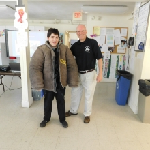 Jessica C. tries on protective clothing with Ken Doucette, Director of Community Affairs at the Middlesex Sheriff's Office.