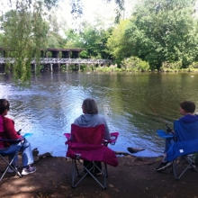 Participants in the Recreation Program enjoyed fishing along the Charles River in Waltham in May.