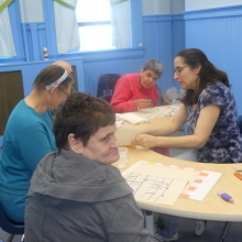 Melissa Kulig conducts an art class with participants at Chestnut Street.