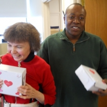 Melinda Nally and Inrick Philogene delivering Valentine cookies to staff members at 56 Chestnut Street.