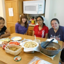 Transitions Summer Program participants (left to right) Angissel Silvestre, Justina Jacobs, Katie Hernandez and Nicole Legere enjoy a meal they shopped for and prepared at Bentley University