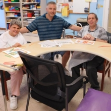 Artist Dan Dressler works with Michelle and Ken to create 3-D works of art exploring shapes.
