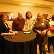 Staff members and consultants gather at the farewell reception for CEO Roz Rubin.