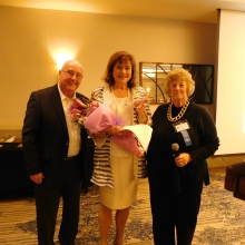 Board co-presidents John Peacock and Marcia MacClary present Roz with a bouquet of flowers at the Annual Meeting