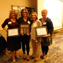 Leah Cosby (left); Siobhan O'Connell, former McDevitt Middle School teacher; Maia Aucoin; and Julie Lamoly, Vice Principal of McDevitt Middle School following the presentation of the John L. Battaglino Award of Excellence to Siobhan and McDevitt Middle School.