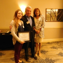 Bud LaCava (center) with Kaitlyn Riley, volunteer and 2019 Board member, and Roz Rubin following the presentation of the Rags LaCava Community Service Award to Kaitlyn.
