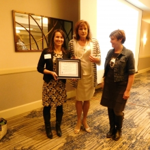 Erica Young (left) and Lisa Lincello (right) accept the 2018 Inaugural Inclusion Award from Roz Rubin.