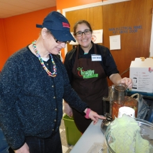 Mary Ann works with Chef Reva of Healthy Waltham to prepare a healthy meal at Chestnut Street.