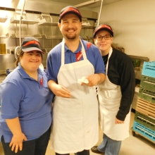 Sheila, Chris, and site manager Amy work in the dish room at one of Brandeis University's dining halls.