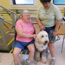 Dianne and Ashley enjoying our Pet Therapy program in July.