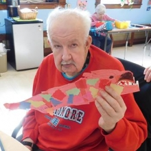We celebrated Chinese New Year in February. Brian Doucette displays the  paper dragon he crafted.