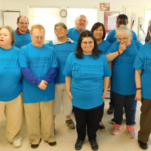 Participants and staff of our Community Based Day Supports (CBDS) program gather with Roz Rubin, CEO, to show off their new 