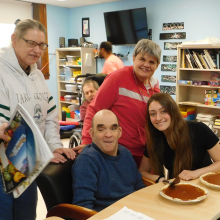 Lesley College student intern Jillian Russo, seated at right, with 