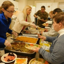 Staff members and volunteers serve a delicious pre-Thanksgiving dinner to CBDS and GSE 