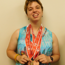 Rosie, a Group Supported Employment participant, recently won three Special Olympics Swimming medals.