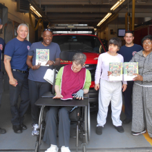 Day Habilitation participants and staff deliver cookies they baked to firefighters at the  Waltham fire station on Moody Street, to say thank you to our first responders.  Firefighters gave our participants booklets on practicing fire safety.