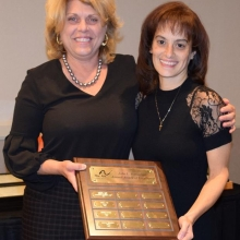 Leah Battaglino Cosby (left) presents the 3rd Annual John L. Battaglino Award for Excellence to Marisol