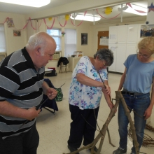 Joan and Bill work on a nature themed art project with CC King!