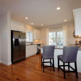 The Kitchen in the Chestnut Condominium opens up to the Dining Area.
