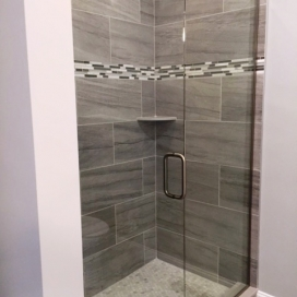 A detail shot of one of our onsite Tile Built Master Bath Showers. Select your shower wall, shower floor, and flooring tile from our designer selections.