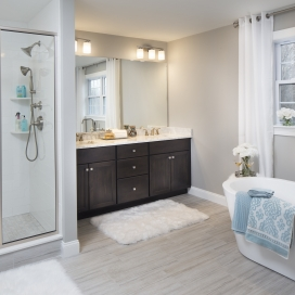 The Master EnSuite Bath features a Tile-Built Shower with Semi-Frameless Glass Door, 2 shelves and overhead light; tile flooring, and depending on the homestyle layout, can include a single or double vanity and a Soaking Tub.