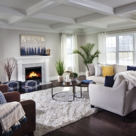 Relax in style and sunlight in your Academy Hill Great Room, complete with Gas Fireplace and Hardwood Flooring. The Lancaster and Richmond homestyles also feature a Coffered Ceiling, as shown here.